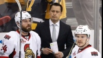 Ottawa Senators head coach Guy Boucher stands behind Viktor Stalberg (24) and Tommy Wingels (57) on the bench during the third period of Game 5 of the Eastern Conference final in the NHL Stanley Cup hockey playoffs in Pittsburgh, Sunday, May 21, 2017.  (AP /Gene J. Puskar)
