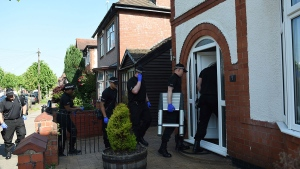 Police at the scene at an address in Nuneaton, England, Thursday May 25, 2017 where they arrested a seventh suspect in the investigation into the Manchester Arena bombing. (Joe Giddens / PA via AP)