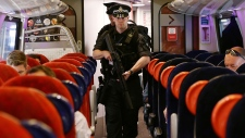 Armed British police on train in London