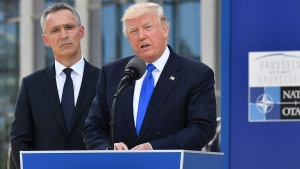 U.S. President Donald Trump, right, speaks as NATO Secretary General Jens Stoltenberg looks on during ceremony at NATO headquarters at the NATO summit in Brussels on Thursday, May 25, 2017. (AP / Geert Vanden Wijngaert)