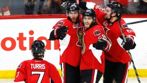 Ottawa Senators right wing Bobby Ryan (9) celebrates his goal against the Pittsburgh Penguins with Kyle Turris (7), Mike Hoffman (68) and Mark Stone (61) during the second period of game six of the Eastern Conference final in the NHL Stanley Cup hockey playoffs in Ottawa on Tuesday, May 23, 2017. THE CANADIAN PRESS/Fred Chartrand