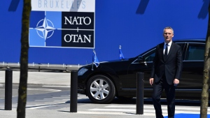 NATO Secretary General Jens Stoltenberg walks at NATO Headquarters before the NATO summit in Brussels on Thursday, May 25, 2017. US President Donald Trump and other NATO heads of state and government on Thursday will inaugurate the new headquarters as well as participating in an official working dinner. (AP Photo/Geert Vanden Wijngaert)