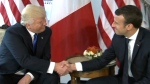 Trump and Macron's strong handshake