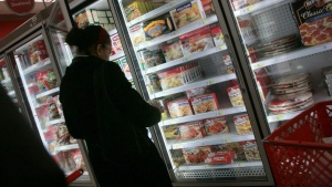 FILE - In this Jan. 11, 2010 file photo, a shopper looks over frozen foods selections at a supermarket in New York. (AP Photos/Bebeto Matthews)