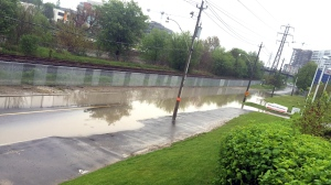 A portion of Bayview Avenue was closed Thursday after heavy rainfall caused flooding. (Nick Dixon/CP24)