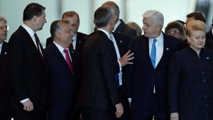Montenegro Prime Minister Dusko Markovic, second right, appears to be pushed by Donald Trump, hidden behind NATO Secretary General Jens Stoltenberg, center, during a NATO summit of heads of state and government in Brussels on Thursday, May 25, 2017. (AP Photo/Matt Dunham)
