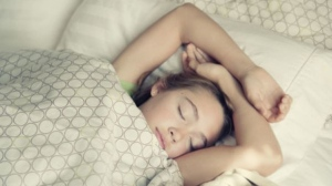 Parents can help their children get enough sleep by being strict about bedtimes, according to researchers. martinedoucet / Istock.com