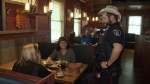 A WRPS officer serving a table as a fundraiser for the Special Olympics on May 25, 2017. (CTV Kitchener)