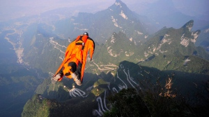FILE -- In this Tuesday, Oct. 8, 2013 photo, Hungarian wingsuit flier Viktor Kovats jumps off a mountain at Tianmen Mountain National Forest Park in Zhangjiajie in south China's Hunan province. (AP Photo)