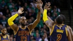 Cleveland Cavaliers forward LeBron James (23) trades high-five's with Cleveland Cavaliers guard Kyrie Irving (2) during the first half of Game 5 of the NBA basketball Eastern Conference finals against the Boston Celtics, on Thursday, May 25, 2017. (AP Photo/Elise Amendola)
