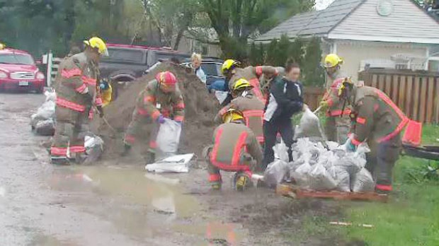 Fire crews and residents spent Thursday filling sandbags and creating a blockade around dozens of waterfront houses in Bowmanville's Cedar Crest Beach community. (CTV News Toronto)