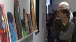 A woman and child look at some art at the Artshine Art Show on May 25, 2017. (CTV Kitchener)
