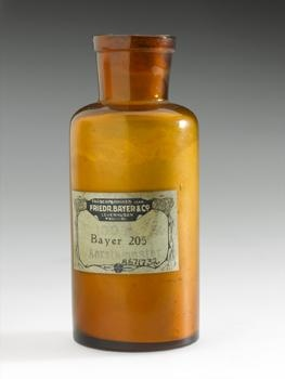 Developed in 1916 by German dye manufacturers Frederich Bayer and Co., Bayer 205 (later renamed suramin) was found to be effective against parasitic trypanosomes responsible for African sleeping sickness (trypanosomiasis). This bottle of suramin powder was given out free of charge for clinical trials of the first production batch. (Science Museum, London.)