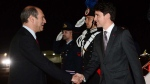Prime Minister Justin Trudeau is greeted by Italian Chief of Protocol Riccardo Guariglia as he arrives in Sigonella, Italy on Friday, May 26, 2017. (THE CANADIAN PRESS/Sean Kilpatrick)
