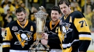 Pittsburgh Penguins' team captain Sidney Crosby (87) holds the Prince of Wales Trophy and poses with assistant captains Evgeni Malkin (71) and Chris Kunitz (14) after defeating the Ottawa Senators in Game 7 of the NHL hockey Stanley Cup Eastern Conference finals to advance to the Stanley Cup finals, Thursday, May 25, 2017, in Pittsburgh. (AP / Keith Srakocic)