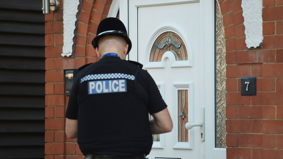A police officer at the scene at an address in Nuneaton, England, Thursday May 25, 2017 where they arrested a seventh suspect in the investigation into the Manchester Arena bombing. (Joe Giddens / PA via AP)