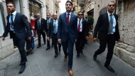 Prime Minister Justin Trudeau makes his way through the streets of Taromina, Italy during the G7 Summit on Friday, May 26, 2017. THE CANADIAN PRESS/Sean Kilpatrick