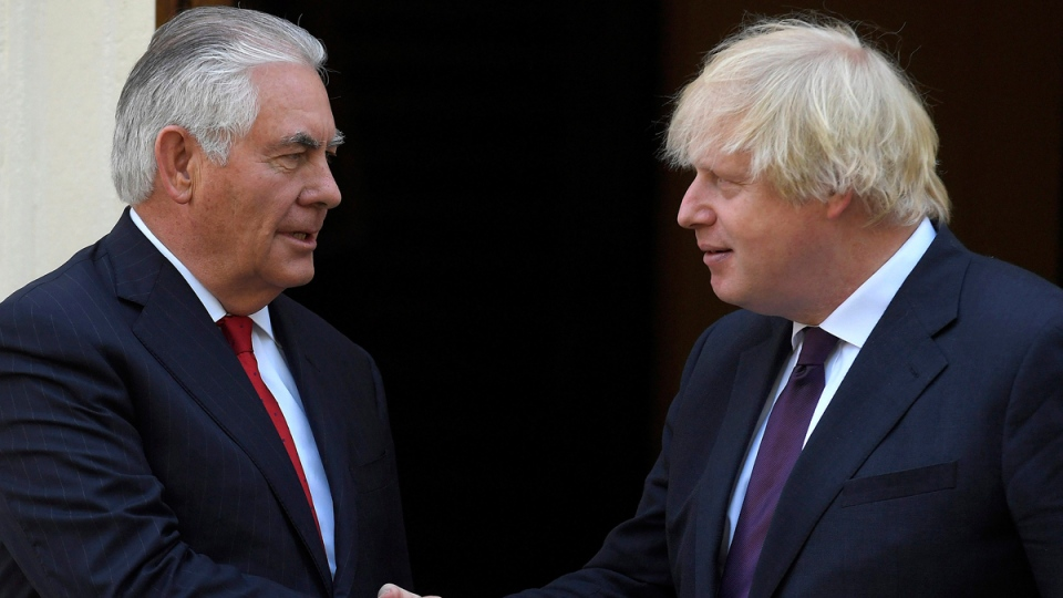 Britain's Foreign Secretary Boris Johnson, right, shakes hands with U.S. Secretary of State, Rex Tillerson, outside Carlton Gardens in London, on May 26, 2017. (Toby Melville/Pool Photo via AP)