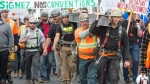 Quebec construction workers march during a demonstration as the province wide strike enters its second day Thursday, May 25, 2017 in Montreal. (Ryan Remiorz / THE CANADIAN PRESS)