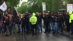 Police officers kept an eye on construction workers protesting outside the Quebec Construction Association's golf tournament on May 26, 2017 (CTV Montreal/Derek Conlon)