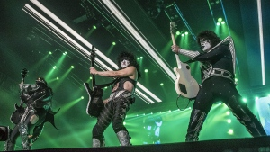 In this Monday, Aug. 15, 2016 photo, Paul Stanley, center, Tommy Thayer, right, and Gene Simmons, of the rock band Kiss perform at The Dow event center in Saginaw, Mich. (Heather Khalifa/The Saginaw News via AP)