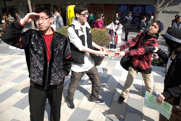 Participants in an event to mark Earth Hour freeze their movement for a few minutes at a shopping mall in Beijing, China, Saturday, March 28 , 2009. (AP / Ng Han Guan)
