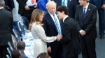 Prime Minister Justin Trudeau shakes hands with Melania Trump as U.S. President Donald Trump looks on at the G7 Summit in Taormina, Italy on May 26, 2017. (Sean Kilpatrick / THE CANADIAN PRESS)