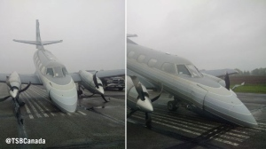 Plane rests on the runway Friday at the Arnprior Airport after landing gear failed Thursday night, May 26, 2017. (Source: TSB)