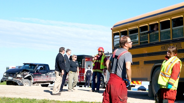 Charges coming after pickup truck rear-ends school bus on highway