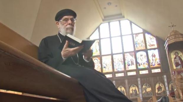 Father Mikhail Aziz prays at Saint Mark Coptic Church in Villeray.