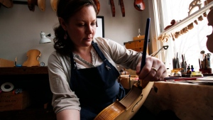 Sonja St. John applies varnish on a violin at her workshop in Neenah, Wis., on Thursday, April 27, 2017. (AP / Carrie Antlfinger)