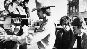 In this Feb. 16, 1984, file photo, Genene Jones, second right, is escorted into Williamson County Courthouse in Georgetown, Texas. (AP Photo / Ted Powers, File)