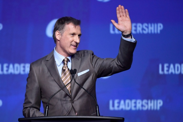 Conservative leadership candidate Maxime Bernier waves to the crowd during the opening night of the federal Conservative leadership convention in Toronto on Friday, May 26, 2017. (Nathan Denette / THE CANADIAN PRESS)