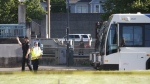 Police investigate a deadly stabbing on a Metropolitan Area Express train in northeast Portland, Ore., Friday, May 26, 2017. (Jim Ryan/The Oregonian via AP)