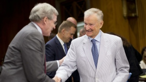 In this July 9, 2014 file photo, former national security adviser Zbigniew Brzezinski, right, is greeted by former National Security Adviser Stephen Hadley, on Capitol Hill in Washington. (AP / Pablo Martinez Monsivais, File)