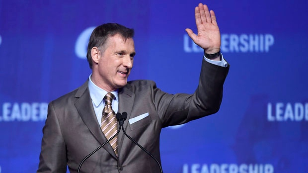 Former Conservative leadership candidate Maxime Bernier waves to the crowd during the opening night of the federal Conservative leadership convention in Toronto on Friday, May 26, 2017. THE CANADIAN PRESS/Nathan Denette