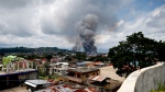 Fire rages at several houses following airstrikes by Philippine Air Force bombers to retake control of Marawi city from Muslim militants in the southern Philippines on Saturday, May 27, 2017. (AP / Bullit Marquez)