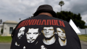 A fan wearing a Soundgarden T-shirt reacts following a funeral for Chris Cornell at the Hollywood Forever Cemetery in Los Angeles on Friday, May 26, 2017. (Photo by Chris Pizzello/Invision/AP)