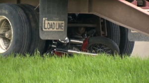 RCMP say a 54-year-old woman on a motorcycle was merging southbound onto the highway from Portage Avenue when she lost control of her motorcycle and was struck by a gravel truck.