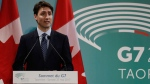 Prime Minister Justin Trudeau holds his G7 closing press conference, in Taormina, southern Italy, Saturday, May 27, 2017. A summit of the leaders of the world's wealthiest democracies has ended without a unanimous agreement on climate change, as the Trump administration plans to take more time to say whether the U.S. is going to remain in the Paris climate deal. (AP Photo/Andrew Medichini)