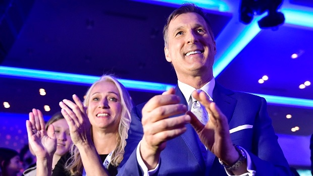 Candidate Maxime Bernier applauds a tribute to Conservative interim leader Rona Ambrose at the federal Conservative leadership convention in Toronto on Saturday, May 27, 2017. THE CANADIAN PRESS/Frank Gunn