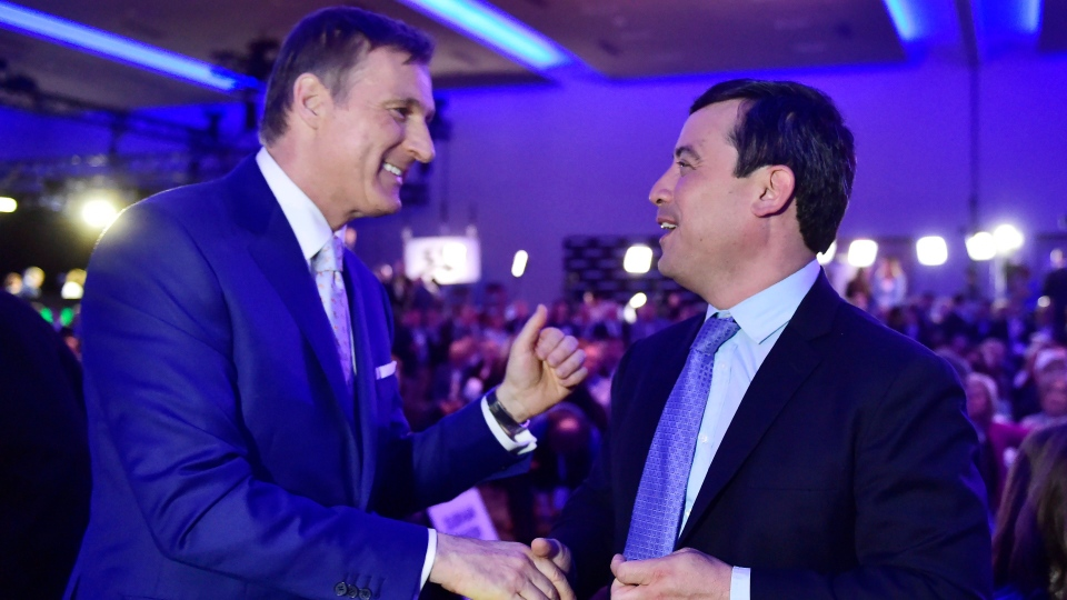 Candidates Maxime Bernier, left, and Michael Chong greet each other at the federal Conservative leadership convention, in Toronto on Saturday, May 27, 2017. THE CANADIAN PRESS/Frank Gunn
