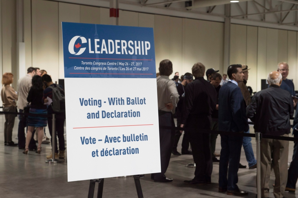 The final line of voters prepares to cast their ballots at the federal Conservative leadership convention in Toronto on Saturday, May 27, 2017. (THE CANADIAN PRESS / Frank Gunn)