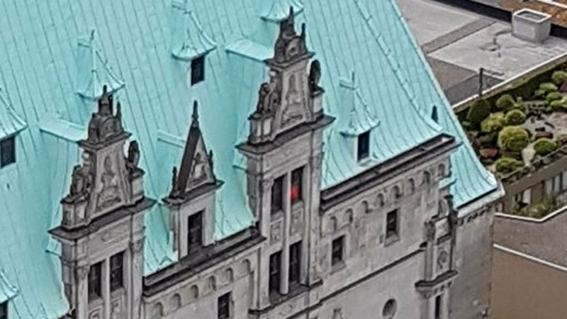 A picture of a red figure at a window of the Fairmont Hotel Vancouver is creating a stir on social media. May 26, 2017. (Twitter/Scott Graham)