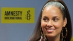 Alicia Keys speaks during a news conference prior to receiving an Ambassador of Conscience Award from Amnesty International recognizing those who have shown exceptional leadership in the fight for human rights in Montreal, Saturday, May 27, 2017. (THE CANADIAN PRESS/Graham Hughes)
