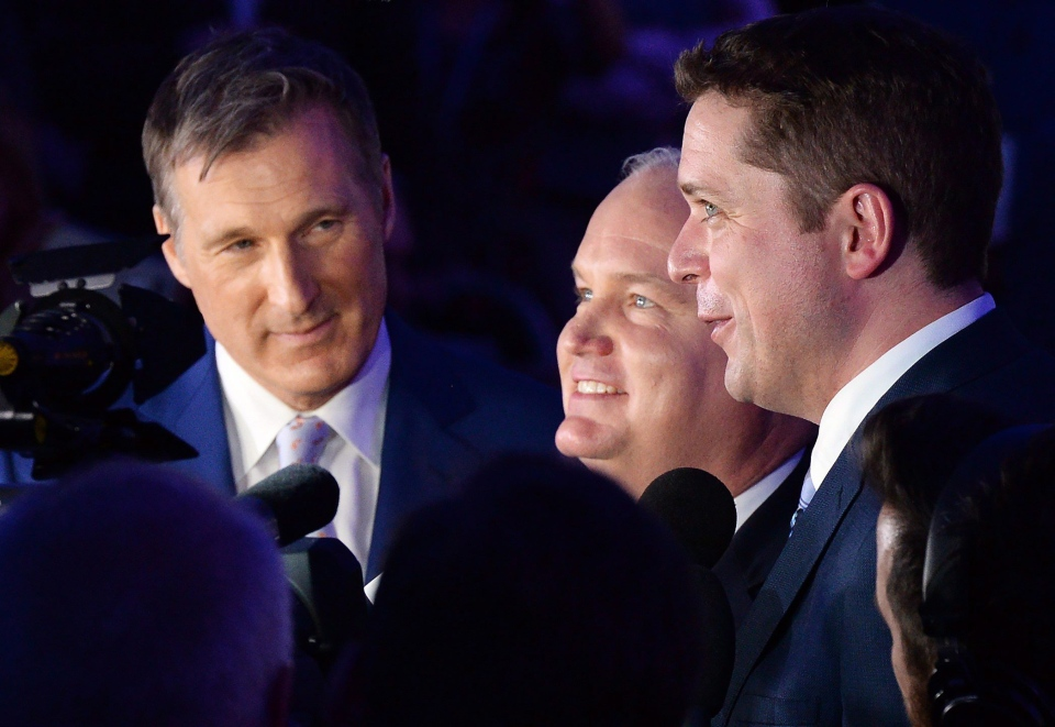 Candidates Maxime Bernier, left to right, Erin O'Toole and Andrew Scheer speak to reporters following the 12th ballot at the federal Conservative leadership convention in Toronto on Saturday, May 27, 2017. (Frank Gunn / THE CANADIAN PRESS)
