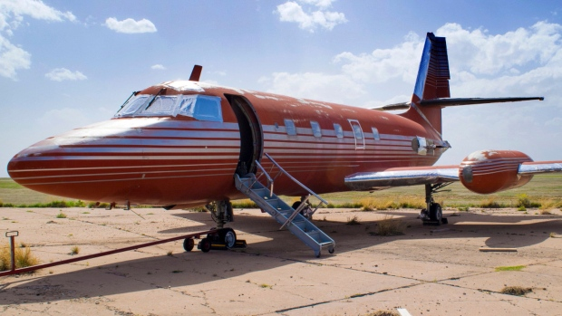 This undated file photo provided by GWS Auctions, Inc. shows a private jet once owned by Elvis Presley, on a runway in New Mexico. (GWS Auctions, Inc. via AP, File)