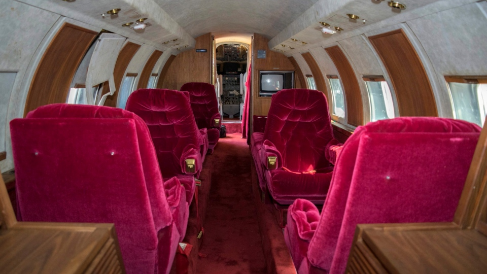 This undated photo provided by GWS Auctions, Inc. shows the interior of a private jet once owned by Elvis Presley on a runway in New Mexico. (GWS Auctions, Inc. via AP)