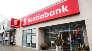 A man leaves Scotiabank in Toronto on Thursday, April 9, 2015. (THE CANADIAN PRESS/Nathan Denette)