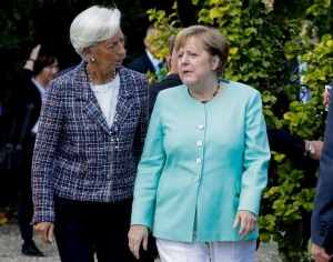 German Chancellor Angela Merkel, right, is flanked by International Monetary Fund Managing Director Christine Lagarde, in the Sicilian town of Taormina, Italy, Saturday, May 27, 2017. (AP / Andrew Medichini)
